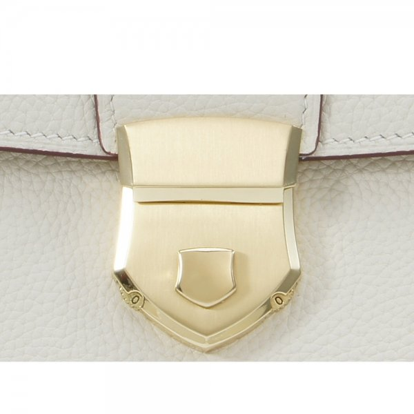 'Follow Me' collection white togo leather backpack padlock close up
