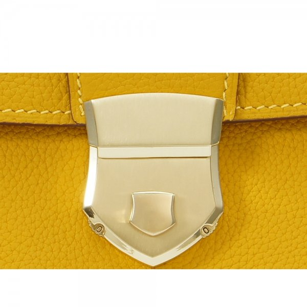 'Follow Me' collection yellow togo leather backpack gold metal padlock close up