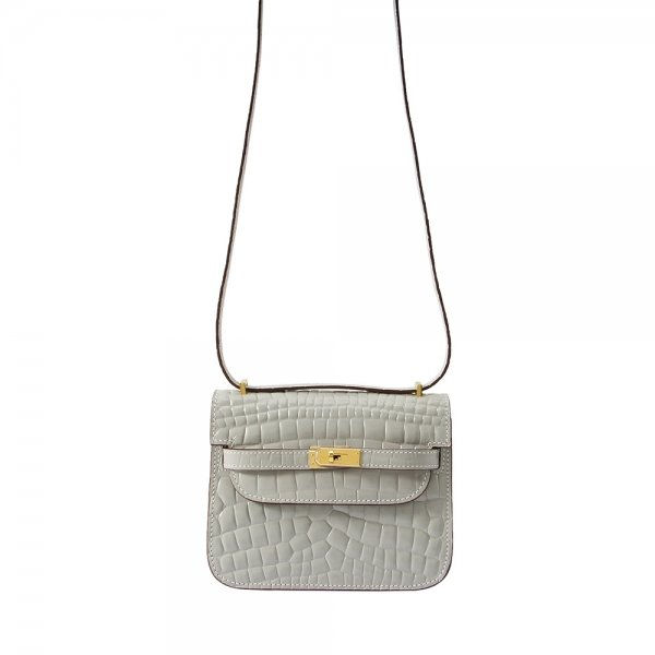 safe flight collection grey croco effect bag hanging by shoulder strap