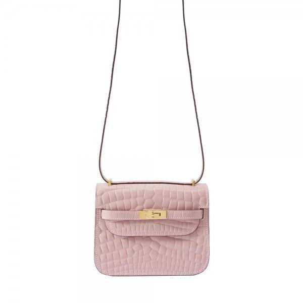 safe flight pink 'croc-effect' leather bag hanging by shoulder strap