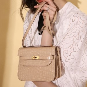 model with pudding color safe flight croco effect shoulder bag