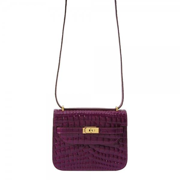 safe flight purple 'croc-effect' bag hanging by shoulder strap